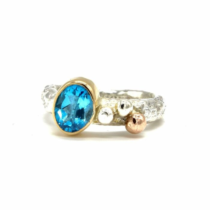 gold and silver topaz ring